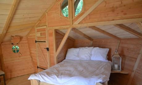 Cabane à louer vue lit